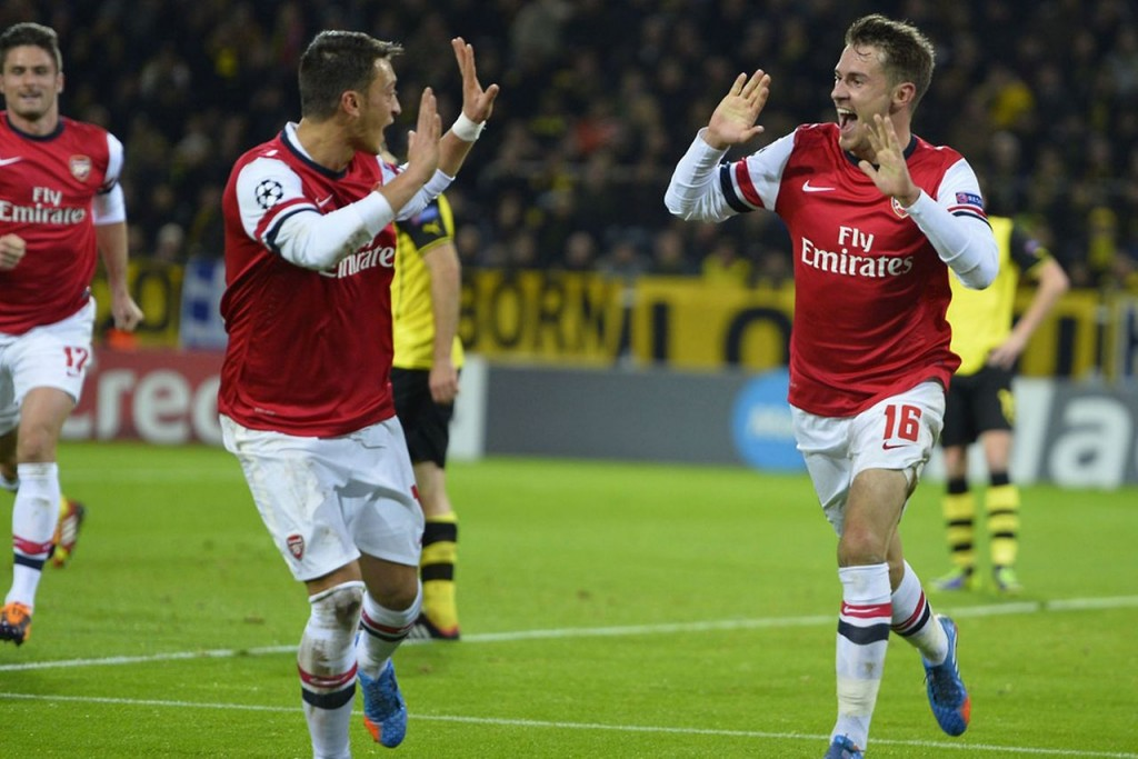 Aaron Ramsay and Mesut Özil celebrate a goal