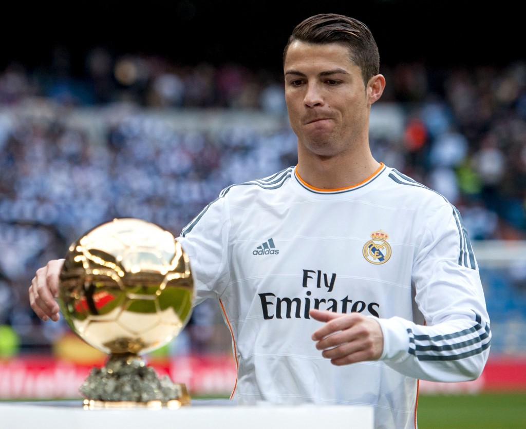 Cristiano Ronaldo holds his FIFA Ballon D'Or trophy before the Spanish league football match between Real Madrid and FC Granada at the Santiago Bernabeu Stadium Featuring: Cristiano Ronaldo Where: Madrid, Spain When: 25 Jan 2014 Credit: SIPA/WENN.com **Only available for publication in Germany. Not available for publication in the rest of the world.**