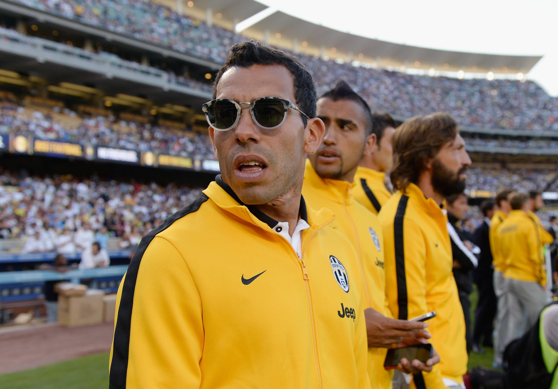 Välinsä päävalmentajan kanssa rikkonut Carlos Tevez keskittyy kisojen aikana lomailemaan perheensä kanssa DisneyLandissa. (Getty)