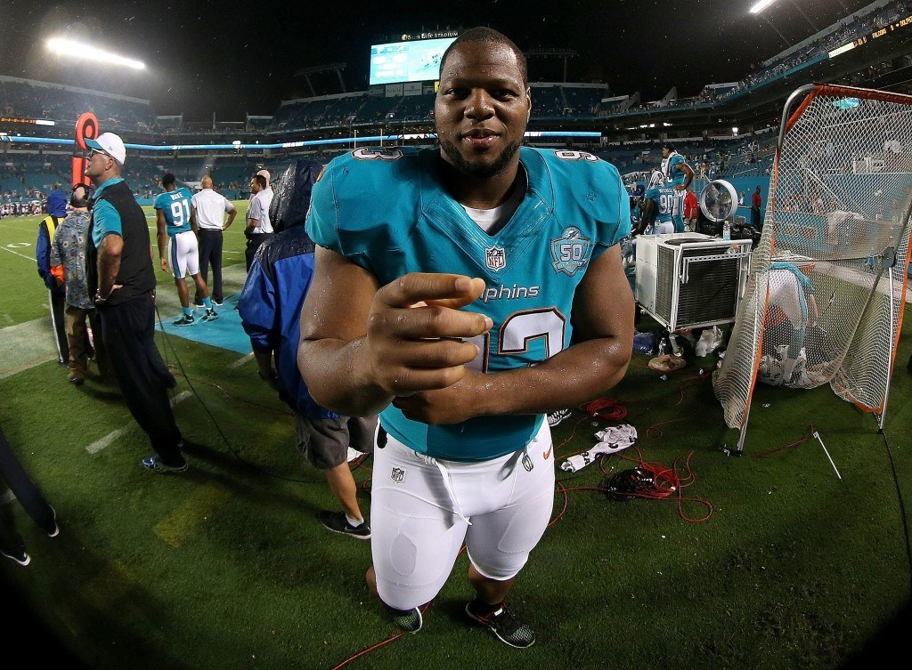 MIAMI GARDENS, FL - AUGUST 29: Ndamukong Suh #93 of the Miami Dolphins looks on during a preseason game against the Atlanta Falcons at Sun Life Stadium on August 29, 2015 in Miami Gardens, Florida. (Photo by Mike Ehrmann/Getty Images)