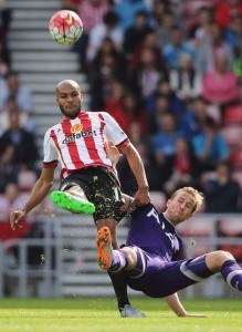 SUNDERLAND, ENGLAND - SEPTEMBER 13: Younes Kaboul of Sunderland clears the ball from Harry Kane of Tottenham Hotspur during the Barclays Premier League match between Sunderland and Tottenham Hotspur at the Stadium of Light on September 13, 2015 in Sunderland, United Kingdom. (Photo by Matthew Ashton/Getty Images)