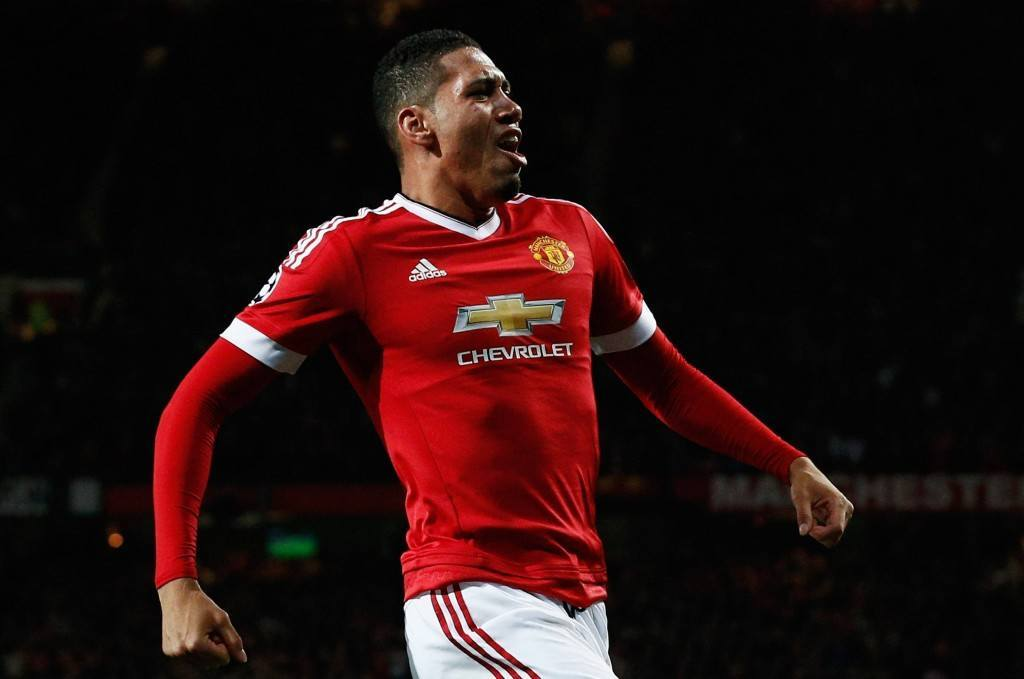 MANCHESTER, ENGLAND - SEPTEMBER 30: Chris Smalling of Manchester United celebrates as he scores their second goal during the UEFA Champions League Group B match between Manchester United FC and VfL Wolfsburg at Old Trafford on September 30, 2015 in Manchester, United Kingdom. (Photo by Dean Mouhtaropoulos/Getty Images)