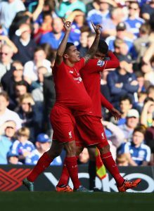 LONDON, ENGLAND - OCTOBER 31: Philippe Coutinho (L) of Liverpool celebrates scoring his team's first goal during the Barclays Premier League match between Chelsea and Liverpool at Stamford Bridge on October 31, 2015 in London, England. (Photo by Ian Walton/Getty Images)