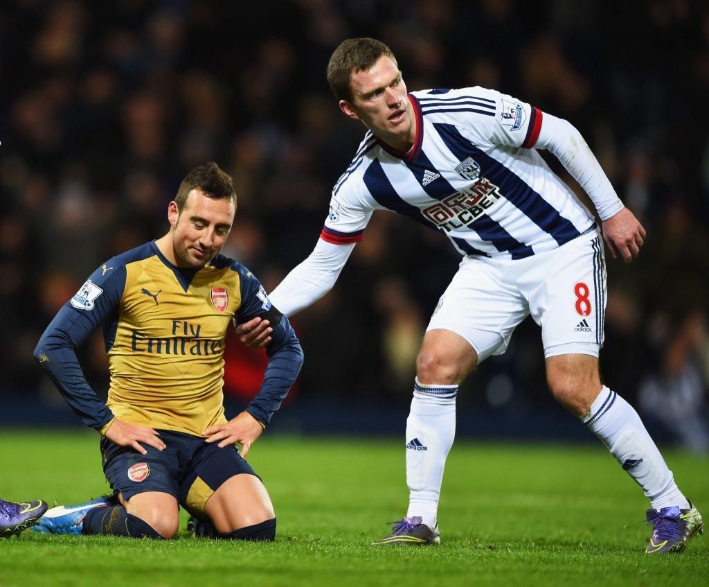 WEST BROMWICH, ENGLAND - NOVEMBER 21: Craig Gardner of West Bromwich Albion consoles Santi Cazorla of Arsenal after his missing the penalty kick during the Barclays Premier League match between West Bromwich Albion and Arsenal at The Hawthorns on November 21, 2015 in West Bromwich, England. (Photo by Shaun Botterill/Getty Images)