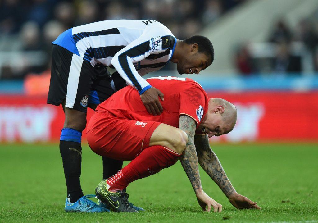 NEWCASTLE UPON TYNE, ENGLAND - DECEMBER 06: Newcastle player Georginio Wijnaldum shows his concern after Liverpool player Martin Skirtel is injured during the Barclays Premier League match between Newcastle United and Liverpool at St James' Park on December 6, 2015 in Newcastle, England. (Photo by Stu Forster/Getty Images)