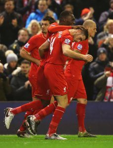 LIVERPOOL, ENGLAND - DECEMBER 13: Jordan Henderson of Liverpool (14) is congratulated by Christian Benteke as he scores their first goal during the Barclays Premier League match between Liverpool and West Bromwich Albion at Anfield on December 13, 2015 in Liverpool, England. (Photo by Alex Livesey/Getty Images)