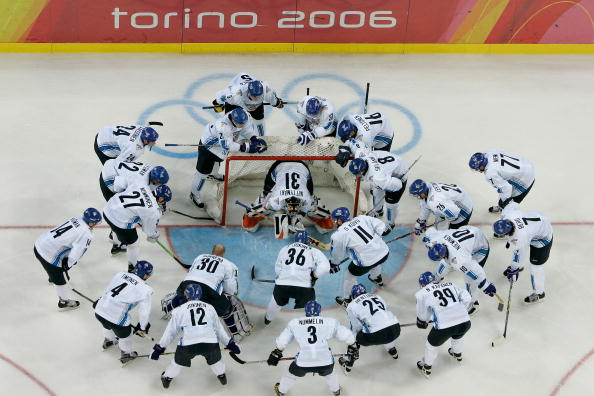 TURIN, ITALY - FEBRUARY 26: Team Finland huddles around the net before the final of the men's ice hockey match between Finland and Sweden during Day 16 of the Turin 2006 Winter Olympic Games on February 26, 2006 at the Palasport Olimpico in Turin, Italy. (Photo by Brian Bahr/Getty Images)