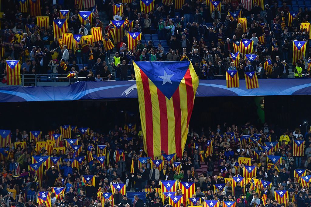 BARCELONA, SPAIN - NOVEMBER 04: FC Barcelona supporters hold Pro-Independence Catalan flags during the UEFA Champions League Group E match between FC Barcelona and FC BATE Borisov at the Camp Nou on November 4, 2015 in Barcelona, Spain. (Photo by David Ramos/Getty Images)