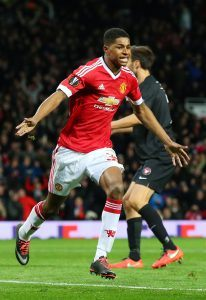 MANCHESTER, ENGLAND - FEBRUARY 25: Marcus Rashford of Manchester United celebrates scoring his team's second goal during the UEFA Europa League Round of 32 second leg match between Manchester United and FC Midtjylland at Old Trafford on February 25, 2016 in Manchester, United Kingdom. (Photo by Alex Livesey/Getty Images)