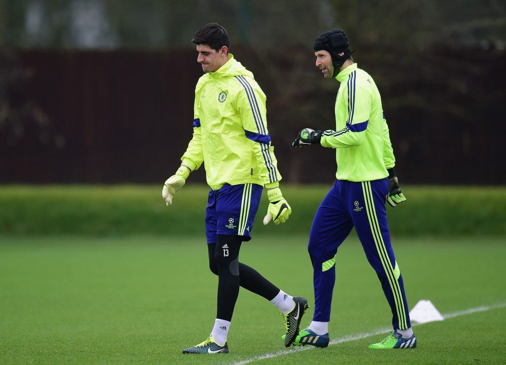 LONDON, ENGLAND - FEBRUARY 16: Thibaut Courtois and Petr Cech of Chelsea talk during a Chelsea training session ahead of the UEFA Champions League round of 16 match against Paris Saint-Germain at Cobham Training Centre on February 16, 2015 in London, United Kingdom. (Photo by Jamie McDonald/Getty Images)