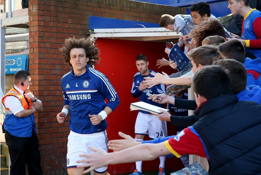 LONDON, ENGLAND - MARCH 29: (L-R) David Luiz and Gary Cahill of Chelsea are greeted by young Palace fans as they run out for the pre-match warm up ahead of the Barclays Premier League match between Crystal Palace and Chelsea at Selhurst Park on March 29, 2014 in London, England. (Photo by Scott Heavey/Getty Images)