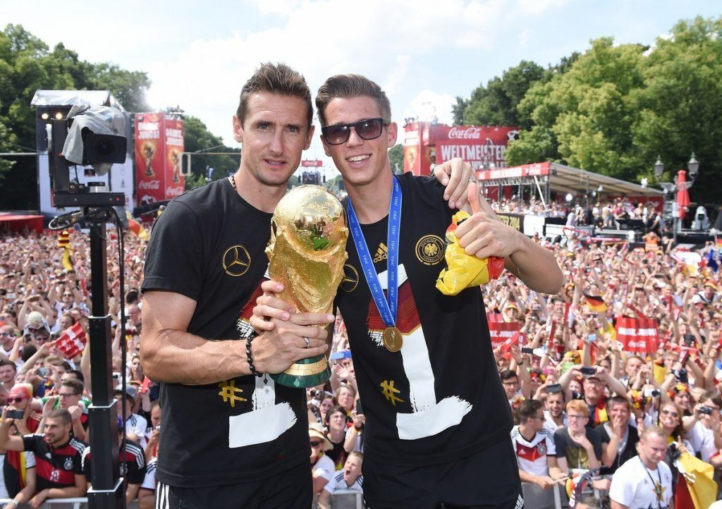 BERLIN, GERMANY - JULY 15: Miroslav Klose and Erik Durm celebrate during the German team victory ceremony on July 15, 2014 in Berlin, Germany. Germany won the 2014 FIFA World Cup Brazil match against Argentina in Rio de Janeiro on July 13. (Photo by Markus Gilliar - Pool /Getty Images)